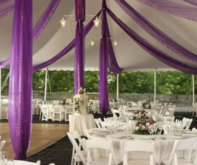 Decorated tent with liner and fabric, tables, chairs and dance floor
