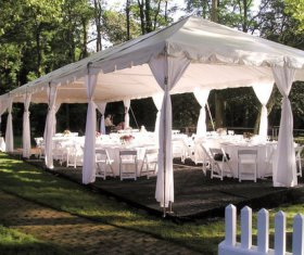 White Victorian Tent with Tables and Chairs