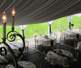 Tented Event with Decorated Tables with Linens and Chiavari Chairs