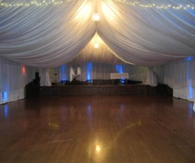 Tent with tent liner including stage and dance floor