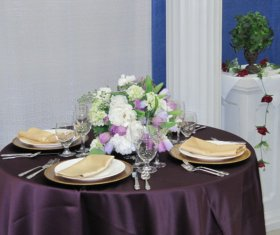 Wedding Table Display with Linens, Napkins, Dinnerware, Chargers and Floral Centerpiece