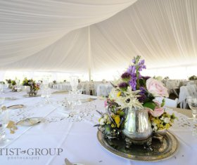 Lovely Centerpiece on Table at Tented Event